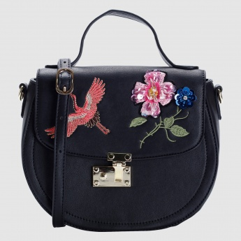 Iconic Embroidered Crossbody Bag with Flap and Metallic Closure