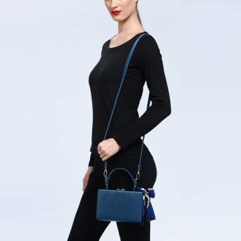 Iconic Hard Case Crossbody Bag with Tassels