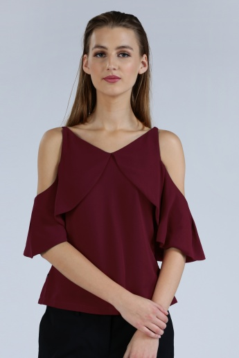 Iconic Cold Shoulder Top with Ruffle Detail and Zip Closure