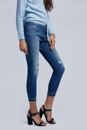 Eco Friendly Distressed 3/4 Length Jeans with Button Closure